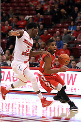 29 November 2014:  Marcus Keene defended by Daishon Knight during an NCAA men's basketball game between the Youngstown State Penguins and the Illinois State Redbirds  in Redbird Arena, Normal IL.