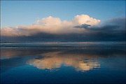 Clouds reflected on the beach