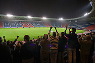 Home supporters celebrating Queen's Park's victory over Alloa Athletic in a Scottish League second division match at Hampden Park, Glasgow, in front of 600 fans at the national stadium, also used by Scotland. The home team won by one goal to nil with a goal by Alan Trouten in the 88th minute. Queen's Park, founded in1867, are currently trying to become only the third FIFA Order of Merit club after Real Madrid and Sheffield FC.