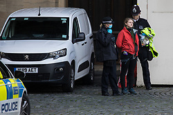 London, UK. 12th November, 2020. Metropolitan Police officers arrest one of a group of three Action for Climate Truth and Reparations (ACTR) activists who had taken part in an action to hang an open letter to the UK people from Africans Rising For Justice, Peace and Dignity from the Houses of Parliament. The letter, which launches Africans Rising's ReRight History campaign, contains a plea to the UK people to start making amends for the harm caused by slavery and colonialism.