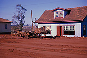 Horse and cart outside wooden house rutted road with red soil, Laranjeiras do Sol, Paraná state