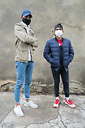 two boys in the street with mask during covid 19 crisis Limoux France May 2020