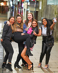 © Licensed to London News Pictures. 24/09/2020. Leeds, UK. Students enjoy a night out in the city center of Leeds. Prime Minister Boris Johnson announced that from Thursday, 24 September, all pubs, bars and restaurants will close at 22:00 pm in England, following a spike in coronavirus cases.  Photo credit: Ioannis Alexopoulos/LNP