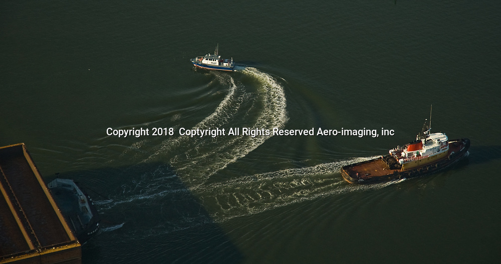 Aerial view of Crowley Cargo Tug Ranger in New York Harbor with pilot boat