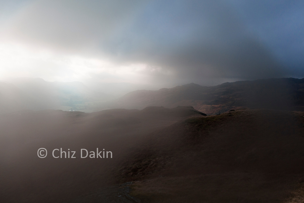 Dense cloud and fog lifting above Eskdale from Border End