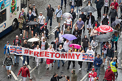 © Licensed to London News Pictures . 27/07/2019. Manchester, UK. An unannounced demonstration in support of jailed former EDL leader Stephen Yaxley-Lennon (aka Tommy Robinson ) blocks buses and cars along Portland Street in Manchester City centre . Up to 200 supporters chanted in support of Yaxley-Lennon as they marched past shoppers . Photo credit: Joel Goodman/LNP