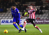 Lincoln City's Lee Frecklington vies for possession with Morecambe's Jordan Cranston<br /> <br /> Photographer Andrew Vaughan/CameraSport<br /> <br /> The EFL Sky Bet League Two - Saturday 15th December 2018 - Lincoln City v Morecambe - Sincil Bank - Lincoln<br /> <br /> World Copyright © 2018 CameraSport. All rights reserved. 43 Linden Ave. Countesthorpe. Leicester. England. LE8 5PG - Tel: +44 (0) 116 277 4147 - admin@camerasport.com - www.camerasport.com