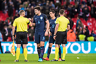 England (6) Harry Maguire, Assistant referee Michal Obukowicz, Referee Pawel Raczkowski, England (17) Jack Cork during the Friendly match between England and Germany at Wembley Stadium, London, England on 10 November 2017. Photo by Sebastian Frej.
