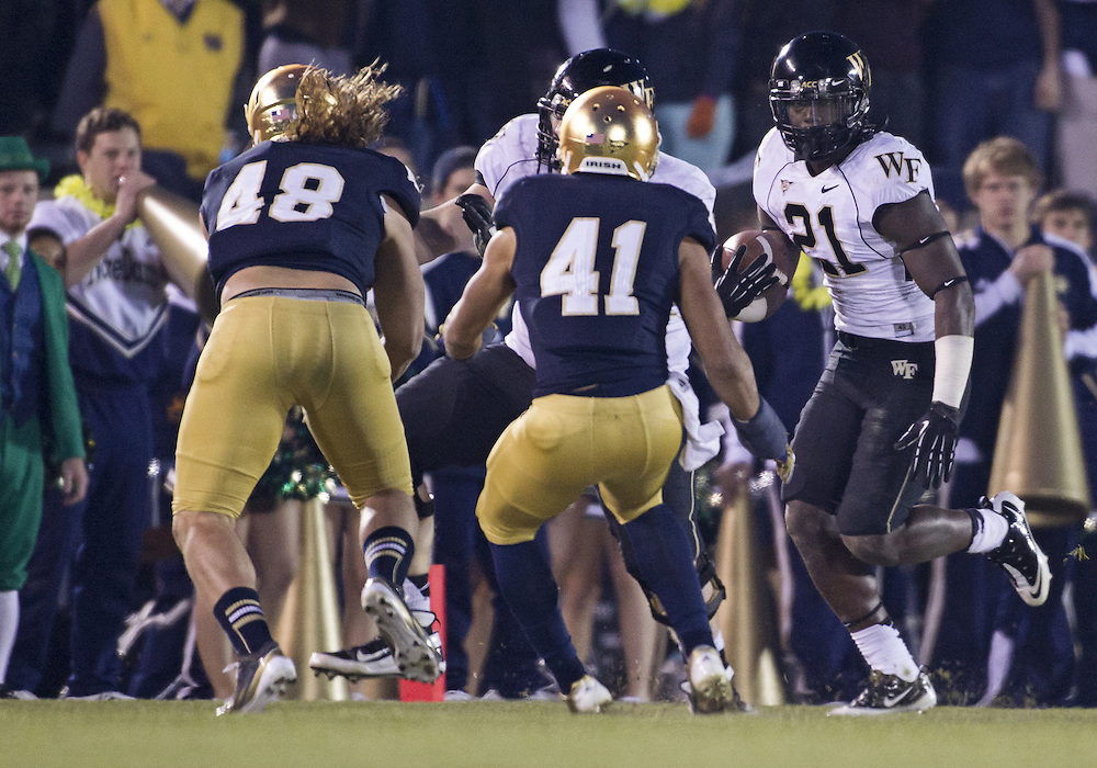 November 17, 2012:  Wake Forest running back Deandre Martin (21) runs the ball during NCAA Football game action between the Notre Dame Fighting Irish and the Wake Forest Demon Deacons at Notre Dame Stadium in South Bend, Indiana.  Notre Dame defeated Wake Forest 38-0.