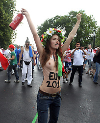 08-06-2012 VOETBAL: EURO 2012 POLEN - GRIEKENLAND: WARSCHAU<br /> The feminist movement Femen protested, in front of the UEFA Euro 2012 Opening Match between Poland and Greece. Police arrest those at the National Stadium Warsaw<br /> ***NETHERLANDS ONLY***<br /> ©2012-FotoHoogendoorn.nl/EXPA/ Newspix/ Aleksander Majdansk