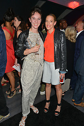 Left to right, CAROLYN CLEWER and TIPHAINE DE LUSSY at a Bastille Day Cocktail Party at L'Escargot, 48 Greek Street, London on 14th July 2014.