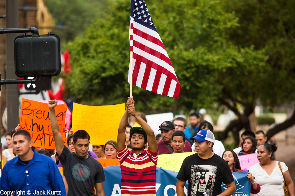 15 AUGUST 2012 - PHOENIX, AZ:   About 200 people, mostly DREAM Act  (an acronym for Development, Relief, and Education for Alien Minors) students and their family members, marched on the Arizona State Capitol in Phoenix Wednesday after Arizona Governor Jan Brewer said the state of Arizona will not give DREAM Act students any state services, including driver's licenses or tuition breaks on state universities and schools. Brewer has been a critic of President Obama's plan to defer deportations of certain undocumented young people.   PHOTO BY JACK KURTZ