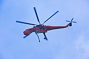 22 JUNE 2010 - FLAGSTAFF, AZ: A firefighting helicopter flies over the line at the Schultz Fire burning north of Flagstaff, AZ. The fire has consumed more than 12,000 acres of forest land and burned within a few feet of homes in some neighborhoods in Flagstaff.   PHOTO BY JACK KURTZ