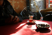 Turkey, Istanbul , The smoke from a cigarette is rising at a traditional tea house for men only