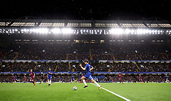 General view as Chelsea's Marcos Alonso runs down the touchline as rain falls