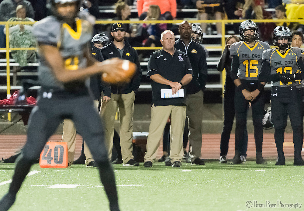 Del Oro Golden Eagle's head coach Casey Taylor, looks on during the third quarter as the Del Oro Golden Eagles varsity football team host the Oak Ridge Trojans, Friday Oct 21, 2016.<br /> photo by Brian Baer