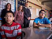 """08 APRIL 2019 - DES MOINES, IOWA: Rep. TIM RYAN (right) and his wife, ANDREA RYAN (center), visit a classroom with a school administrator at Callanan Middle School. Ryan, a candidate for the Democratic ticket of the US presidency, visited Callanan Middle School in Des Moines to discuss education issues. Ryan declared his candidacy on the US television show """"The View"""" on April 4. Ryan, 45 years old, represents Ohio's 13th District, which includes Lordstown, where a large General Motors plant recently closed. He is the latest Democrat to announce his candidacy to be the Democratic nominee in the 2020 election. Iowa holds its presidential caucuses on Feb. 3, 2020.       PHOTO BY JACK KURTZ"""
