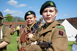 Reenactors from the  61st Reconnaissance Regiment Living History Group part of the British 50th Division wait to take part in a firing display <br /> <br />   04May 2015<br />   Image © Paul David Drabble <br />   www.pauldaviddrabble.co.uk