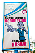 Rwanda February 2014. Anti corruption billboard on the street encouraging people to 'blow the whistle' on corruption and giving a number to ring.The poster is in English and Kinyarwanda.