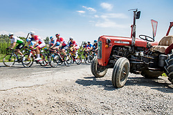 Peloton and tractor during 3rd Stage of 26th Tour of Slovenia 2019 cycling race between Zalec and Idrija (169,8 km), on June 21, 2019 in Slovenia. Photo by Matic Klansek Velej / Sportida