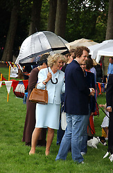 HRH The DUCHESS OF CORNWALL and her son TOM PARKER-BOWLES at the 3rd annual Macmillan Dog Day in aid of Macmillan Cancer Relief held at Royal Hospital Chelsea, London SW3 on 5th July 2005.<br />