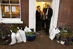 © Licensed to London News Pictures. 17/02/2020. Upton-upon-Severn, Worcestershire, UK. Sandbags are in place, and it's business as usual at cosy riverside pubs whose are protected from the river Severn by strong flood barriers. A severe flood warning is in force and plans to evacuate residents is under way at Upton-upon-Severn, in Worcestershire, UK. It has been reported that a new peak of flood water levels will occur at 04.00 hrs on Tuesday 18th February 2020. and these new levels are expected to breach the flood protection barriers which have protected the small town of Upton-upon-Severn in Worcestershire for many years. Photo credit: Graham M. Lawrence/LNP