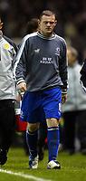 Photo. Aidan Ellis.<br /> Manchester United v Everton.<br /> FA Barclaycard Premiership.<br /> 26/12/2003. <br /> Everton's Wayne Rooney trudges of at the end