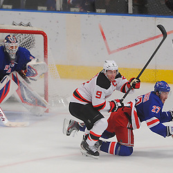 May 16, 2012: New Jersey Devils left wing Zach Parise (9) checks New York Rangers defenseman Ryan McDonagh (27) with the puck closing in during third period action in game 2 of the NHL Eastern Conference Finals between the New Jersey Devils and New York Rangers at Madison Square Garden in New York, N.Y. The Devils defeated the Rangers 3-2.