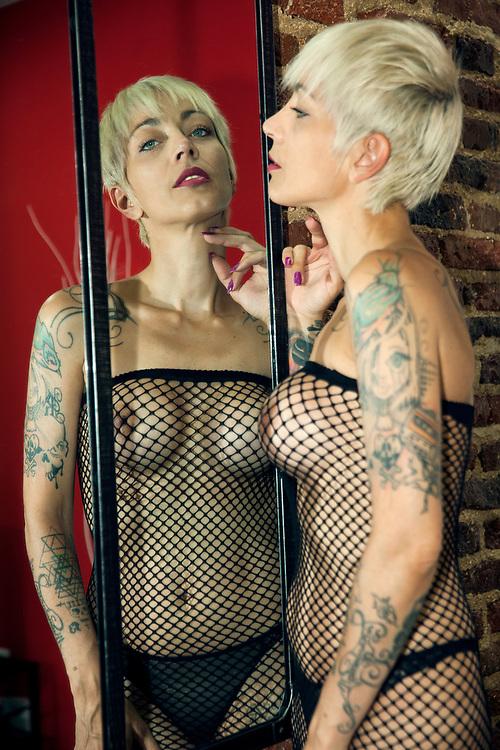 Sexy tattooed blond model posing in lingerie