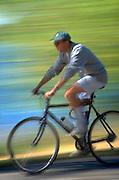 Man age 23 riding bicycle at Lake Harriet.  Minneapolis  Minnesota USA