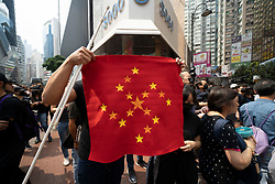 Hong Kong. 29 September, 2019. Illegal march by thousands of pro-democracy supporters from Causeway Bay to Government offices at Admiralty is under way. Police unsuccessfully attempted to stop march at start with teargas fired and scuffles. March marks the 5th anniversary of the start of the Umbrella Movement. Iain Masterton/Alamy Live News.