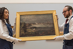 """© Licensed to London News Pictures. 01/12/2017. London, UK.  Technicians present """"The Opening of Waterloo Bridge"""", circa 1819-20, by John Constable, (Est. GBP1.0-1.5m).  Preview of """"Masters of Light"""", Sotheby's Old Masters Evening Sale which will take place on 6 December at Sotheby's, New Bond Street. Photo credit: Stephen Chung/LNP"""