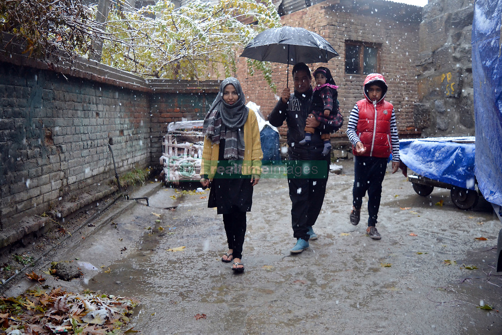 A Kashmiri family seen enjoying in the snow in Srinagar, the summer capital of Indian controlled Kashmir. Kashmir witnessed its first snowfall.