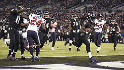 November 27, 2017 - Baltimore, MD, USA - Baltimore Ravens running back Alex Collins rushes for a touchdown in the second quarter against the Houston Texans on Monday, Nov. 27, 2017 at M&T Bank Stadium in Baltimore, Md. (Credit Image: © Ulysses Munoz/TNS via ZUMA Wire)