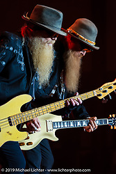 Dusty Hill (left) and Billy Gibbons of ZZ Top play on the Wolfman Jack stage at the Buffalo Chip Campground during the annual Sturgis Black Hills Motorcycle Rally. SD, USA. August 6, 2014.  Photography ©2014 Michael Lichter.