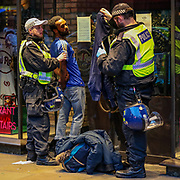 British mounted police officers arrested a homeless man, who claims to be a supporter of the BLM at Piccadilly Circus, in central London, Saturday, June 13, 2020. British police have imposed strict restrictions on groups protesting in London Saturday in a bid to avoid violent clashes between protesters from the Black Lives Matter movement, as well as far-right groups that gathered to counter-protest.<br /> Anger against systemic levels of institutional racism has raged through the city, and worldwide; sparked by the death of George Floyd, who was killed in Minneapolis, US, by a policeman who restrained him with force on 25 May 2020. (Photo/ Vudi Xhymshiti)