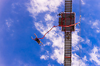 Man jumping off of the 100 meter (328 foot) bungee jump at Orlando Towers at the decomissioned Orlando Power Station (former coal fired power station), Soweto, Johannesburg, South Africa.