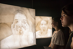"""© Licensed to London News Pictures. 28/06/2018. LONDON, UK. Visitors view """"5 Stages of Maya Dance"""", 2018, by Marina Abramovich. Members of the public visit Masterpiece London, the world's leading cross-collecting art fair held in the grounds of the Royal Hospital Chelsea.  The fair brings together 160 international exhibitors presenting works from antiquity to the present day and runs 28 June to 4 July 2018.  Photo credit: Stephen Chung/LNP"""