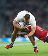Twickenham, England.  England's, Keiran BROOKES, held up by France's ,Yannick NYANGA, during the QBE International. England vs France [World cup warm up match]  Saturday.  15.08.2015,  [Mandatory Credit. Peter SPURRIER/Intersport Images].