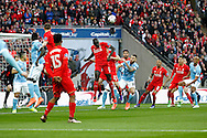 Mamadou Sakho of Liverpool (c) heads the ball clear. Capital One Cup Final, Liverpool v Manchester City at Wembley stadium in London, England on Sunday 28th Feb 2016. pic by Chris Stading, Andrew Orchard sports photography.