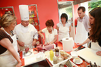 """Lenotre Ecole Culinaire, Paris,..short course - """"Return to the Market"""" with Chef Jacky Legras..students cut the tuna..photo by Owen Franken for the NY Times..July 12, 2007......."""