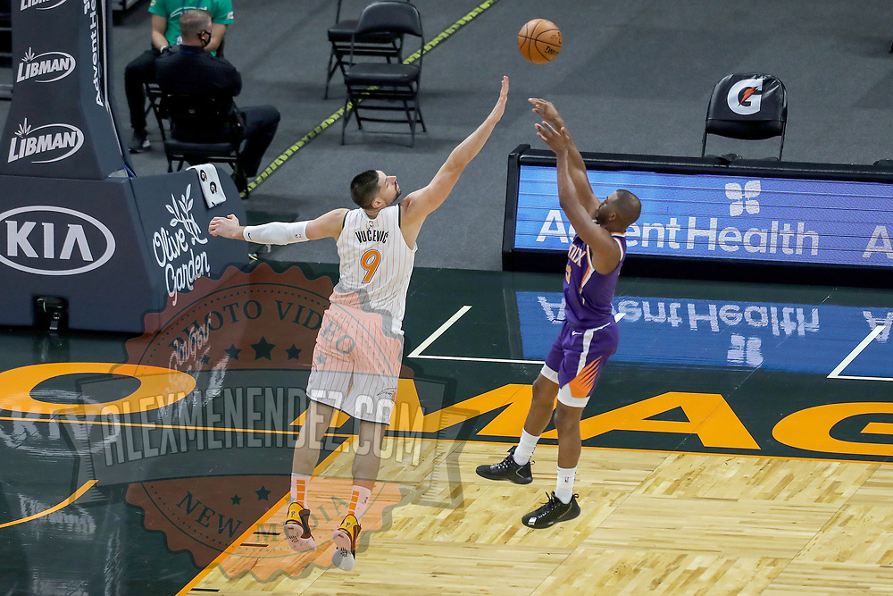 ORLANDO, FL - MARCH 24: Chris Paul #3 of the Phoenix Suns attempts a shot over Nikola Vucevic #9 of the Orlando Magic during the second half at Amway Center on March 24, 2021 in Orlando, Florida. NOTE TO USER: User expressly acknowledges and agrees that, by downloading and or using this photograph, User is consenting to the terms and conditions of the Getty Images License Agreement. (Photo by Alex Menendez/Getty Images)*** Local Caption *** Chris Paul; Nikola Vucevic
