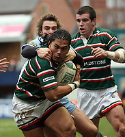 Photo: Rich Eaton.<br /> <br /> Leicester Tigers v Cardiff Blues. Heineken Cup. 13/01/2007.Alesana Tuilagi attacks for Leicester Tigers tackled by Nick Robinson of Cardiff