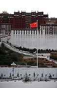 A Chinese flag waves in front of the Potala.