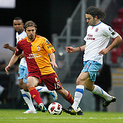 Galatasaray's Ayhan AKMAN (L) and Trabzonspor's Selcuk INAN (R) during their Turkish superleague soccer derby match Galatasaray between Trabzonspor at the TT Arena in Istanbul Turkey on Sunday, 10 April 2011. Photo by TURKPIX