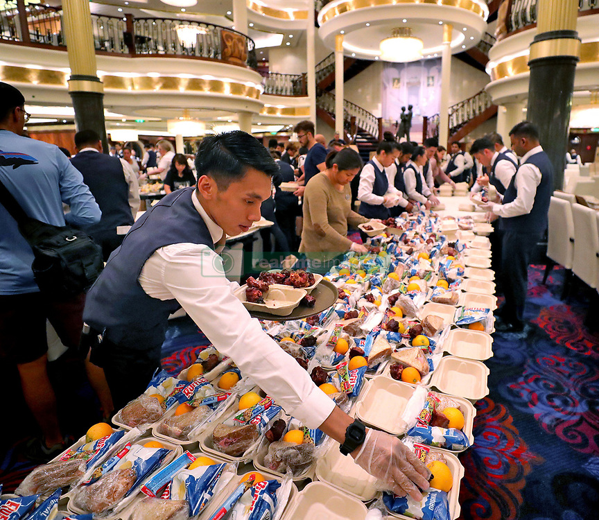 Crew members on Royal Caribbean's Mariner of the Seas convert the cruise ship's main dining room into an assembly line to put together 10,000 relief meals, late Friday night, September 6, 2019, en route to Freeport, Bahamas. Photo by Joe Burbank/Orlando Sentinel/TNS/ABACAPRESS.COM