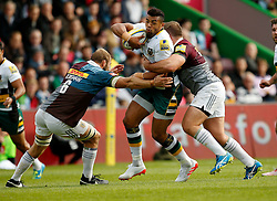 Northampton Saints' Luther Burrell and Harlequins' Chris Robshaw and Harlequins' Rob Buchanan during the Aviva Premiership match at Twickenham Stoop, London.