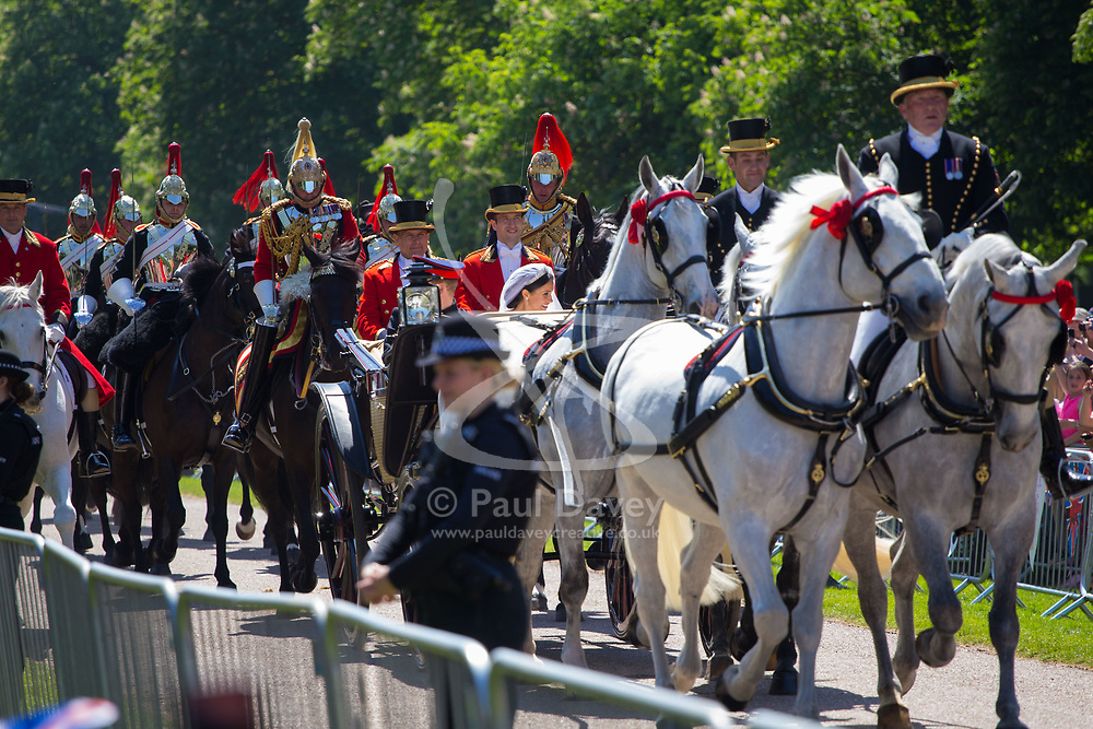 Newly married Prince Harry and Meghan Markle 's procession heads towards Windsor Castle following the royal wedding. Windsor, May 19 2018.