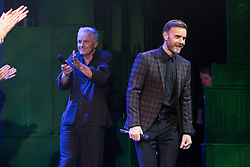 """© Licensed to London News Pictures . 12/01/2016 . Salford , UK . Writers GARY BARLOW (r) and TIM FIRTH (l) make a surprise appearance and Barlow performs in front of the audience at the Lowry Theatre ,  during the opening week of """" The Girls """" , a musical they wrote based on the story """" Calendar Girls """" , about a group of Women's Institute members in Yorkshire , who made a nude calendar . Photo credit : Joel Goodman/LNP"""