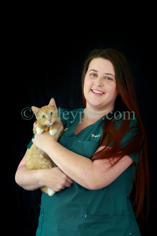 14 January 2014. New Orleans, Louisiana.<br /> Lakeview Veterinary Hospital Inc. <br /> Traci Timmons, technician. Pictured with kitten Fiyero.<br /> Photo Credit; Charlie Varley